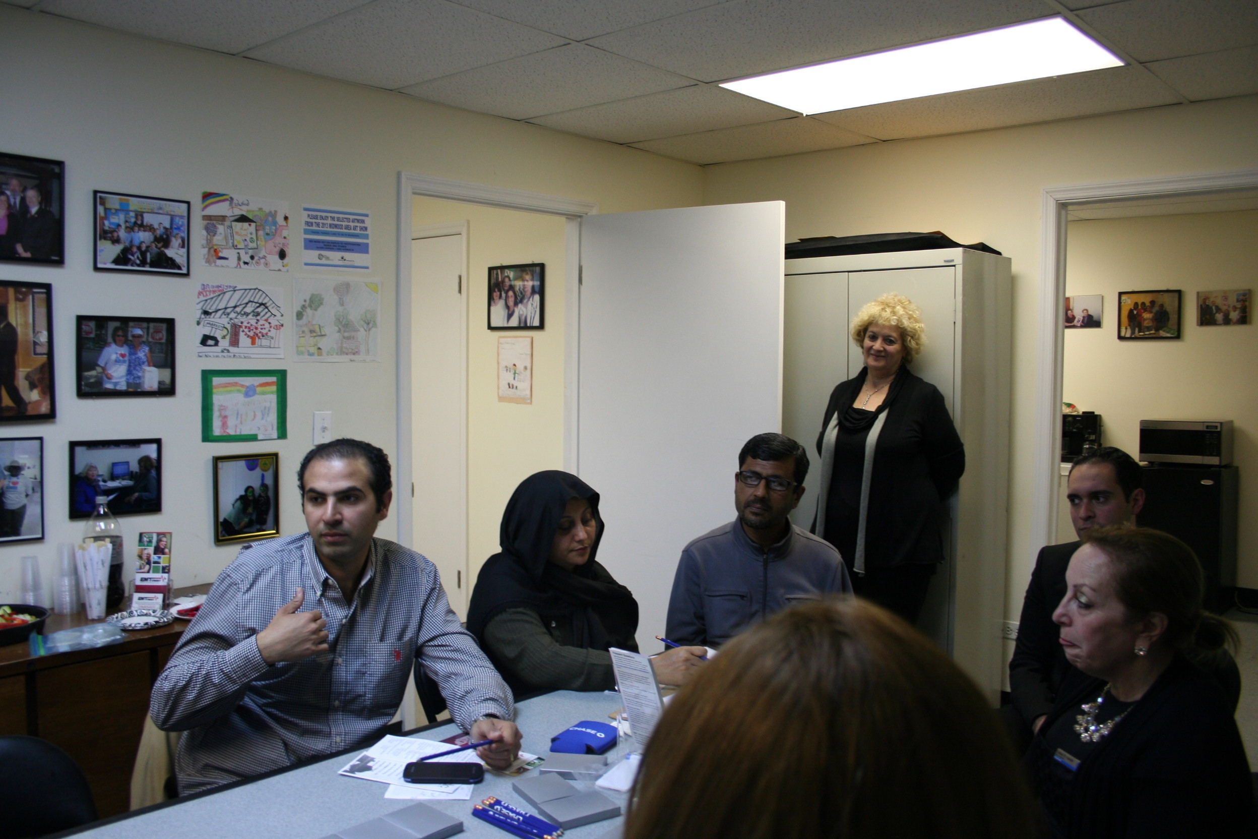 housing workshop highlights midwood development corporation left to right clients ibrahim nabil noar ahmad amtul latif mdc housing counselor nina akopyan chase relationship banker moshe moshiach and chase